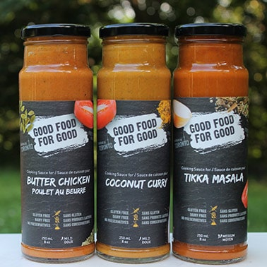Straight on view of 3 bottles of Good Food For Good sauces