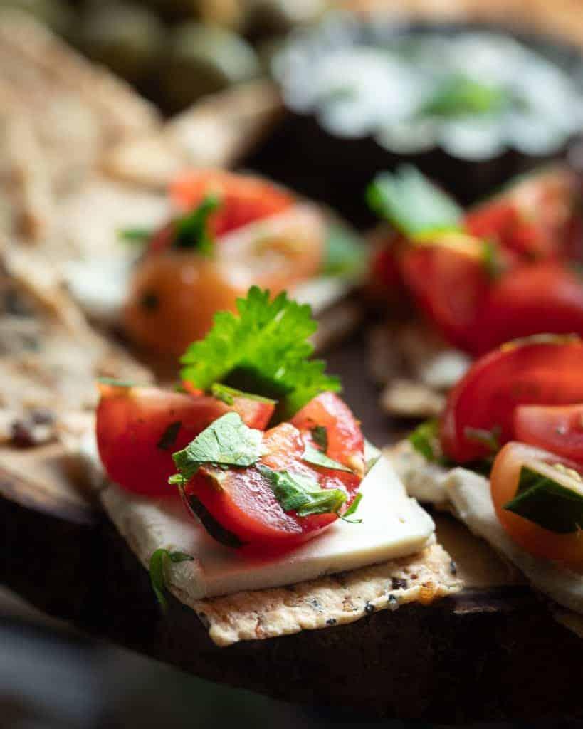 close up of tomato salsa on a gluten free cracker