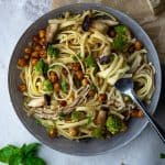 bowl of fresh pasta with cawliflower and mushrooms and chickpeas