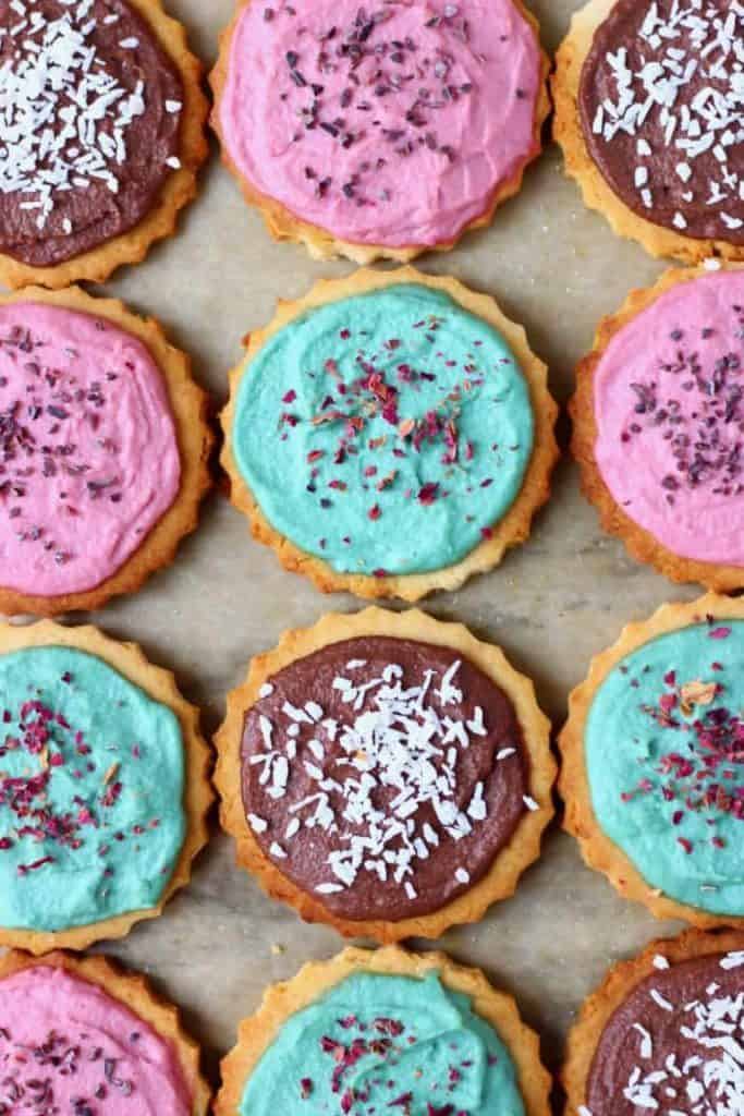 Vegan gluten free sugar cookies with blue, red and chocolate frosting