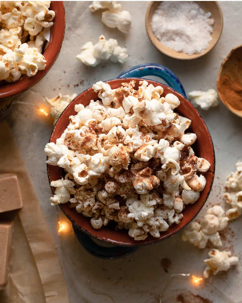 bowl of popcorn with cinnamon butter on top