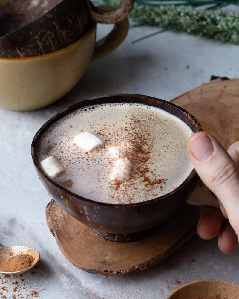 easy hot chocolate recipe, hot chocolate in a cup being held
