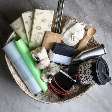 wicker basket full of eco-friendly gift ideas