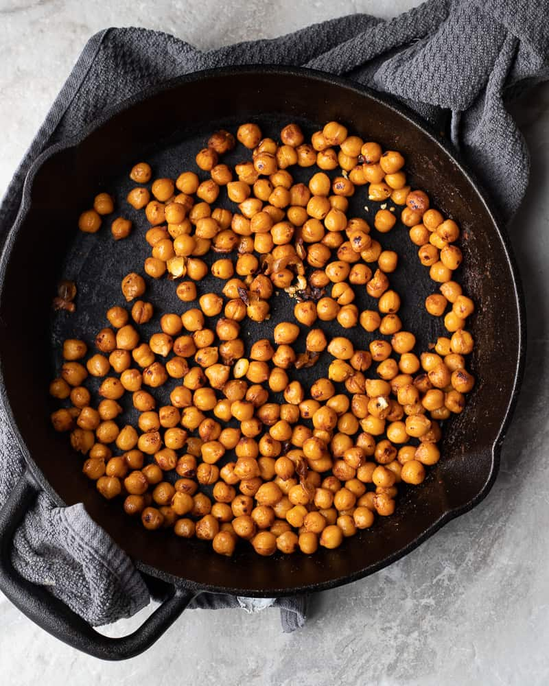cast iron pan with gluten free crispy chickpea croutons