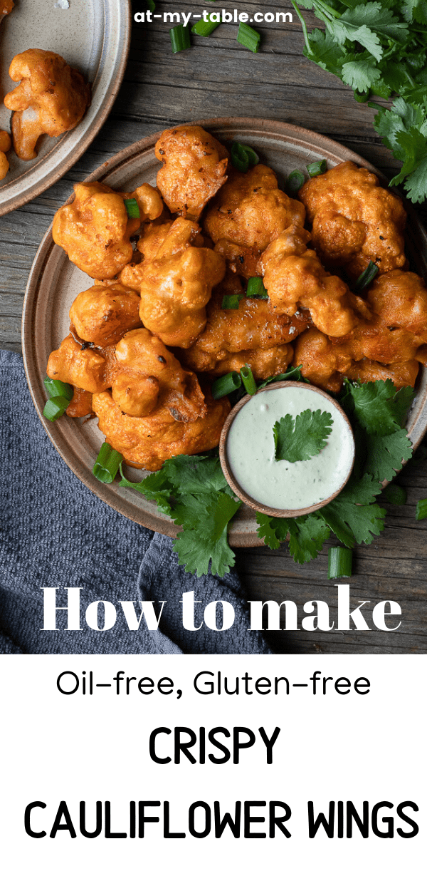 a plate full of buffalo cauliflower wings with a cilantro dipping sauce surrounded by cilantro and text overlay
