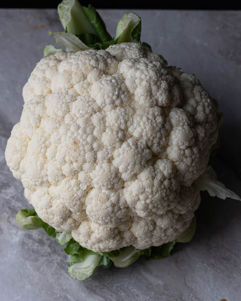 head of cauliflower washed and ready to be chopped