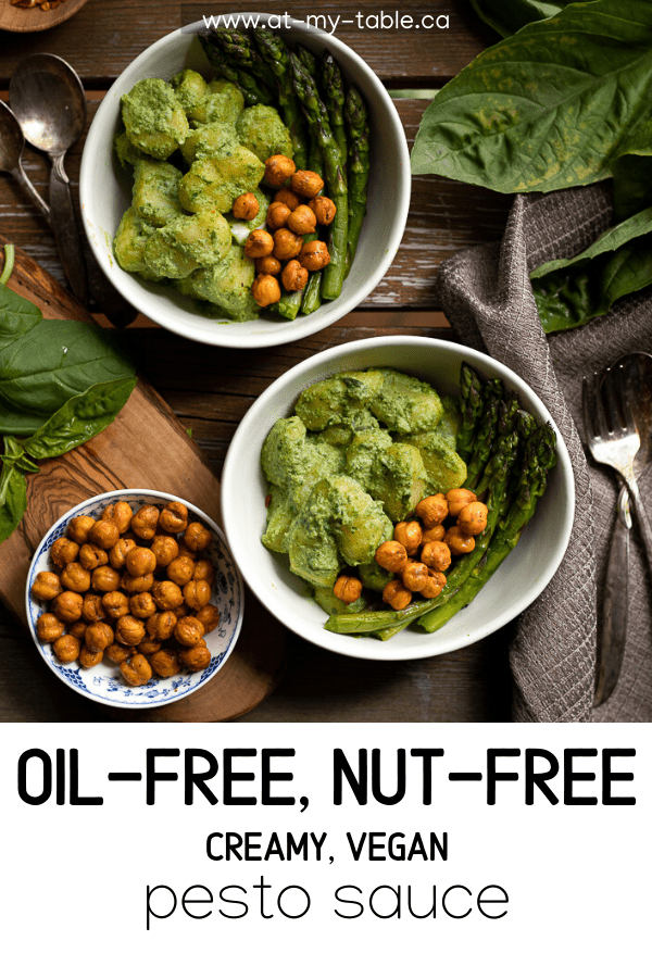 Birds eye view of bowls of creamy oil free pesto sauce over gnocchi and chickpeas with text overlay