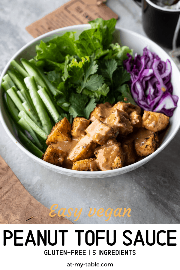 Easy peanut tofu recipe made with simple ingredients. A bowl of tofu with a peanut glaze and fresh veggies