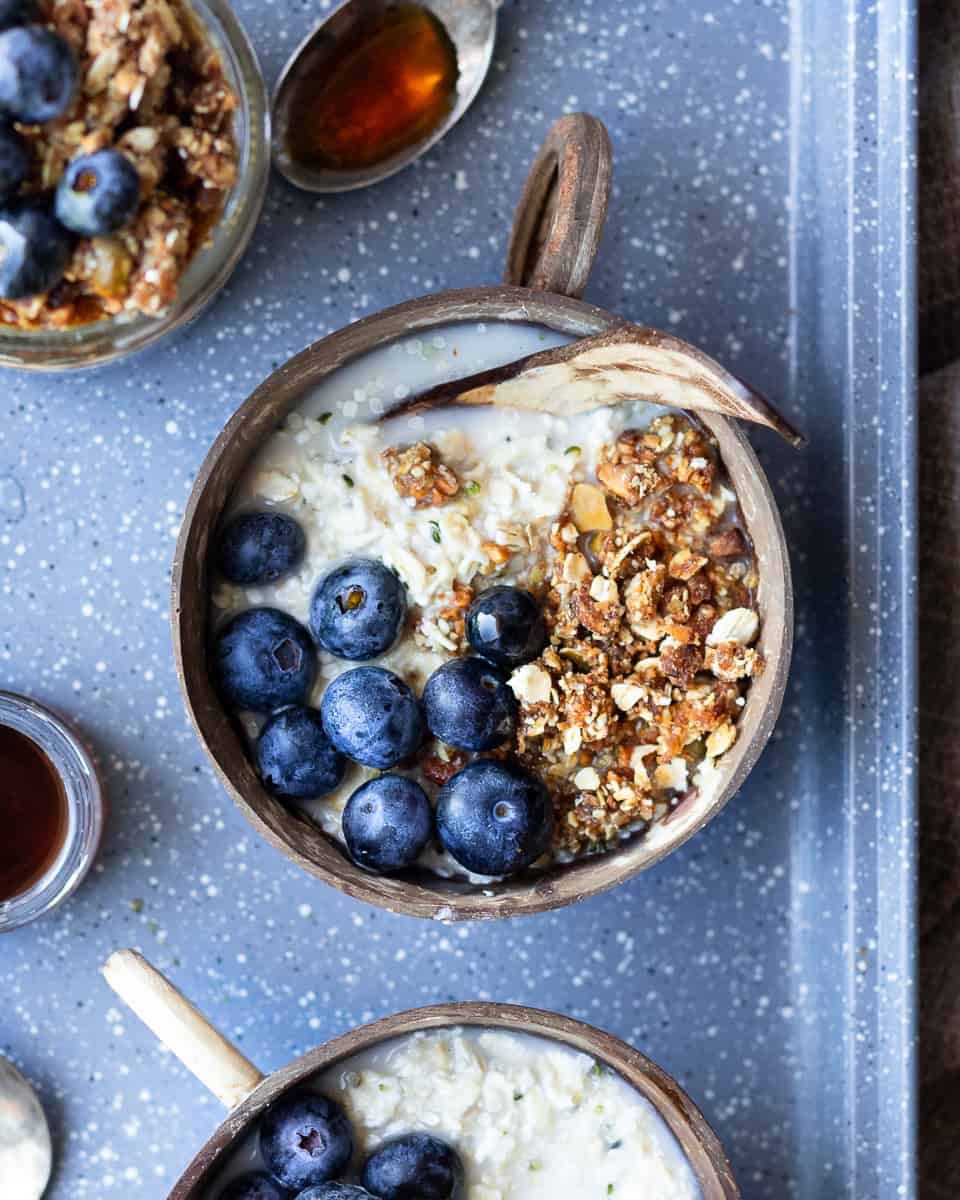 Top down view of a bowl of overnight oats with fresh blueberries and granola