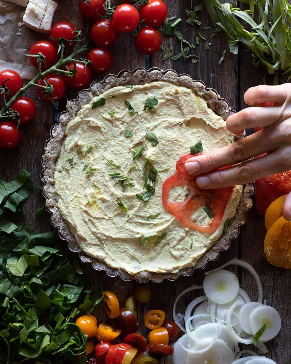 Birds eye view of a easy vegan quiche with a gluten free pie crust being prepared