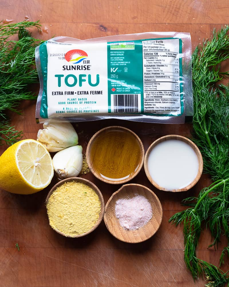 Prep shot of the ingredients to make vegan tofu ricotta on a cutting board