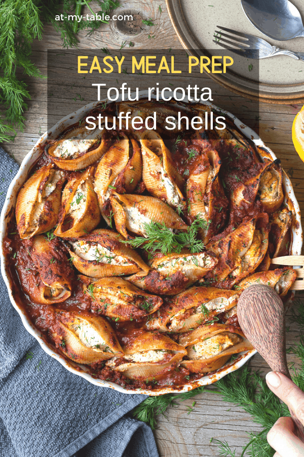 Birds eye view of a dish of tofu ricotta baked pasta shells. A vegan and gluten free recipe being served.